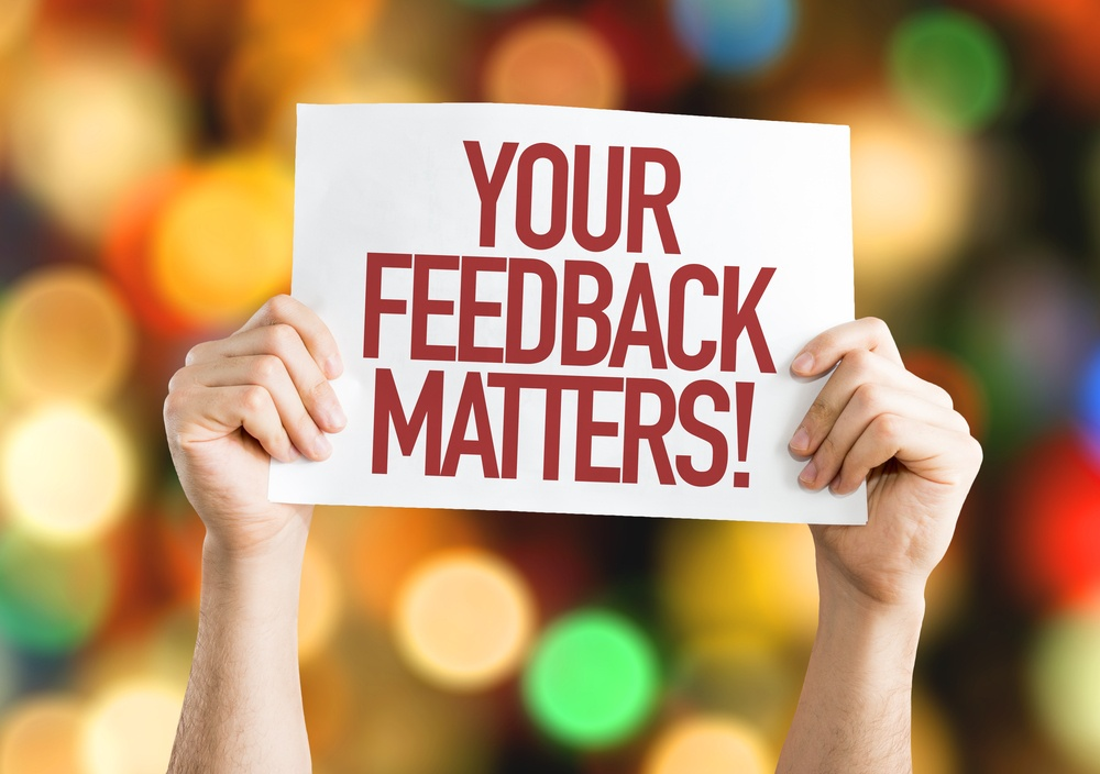 Your Feedback Matters placard with bokeh background
